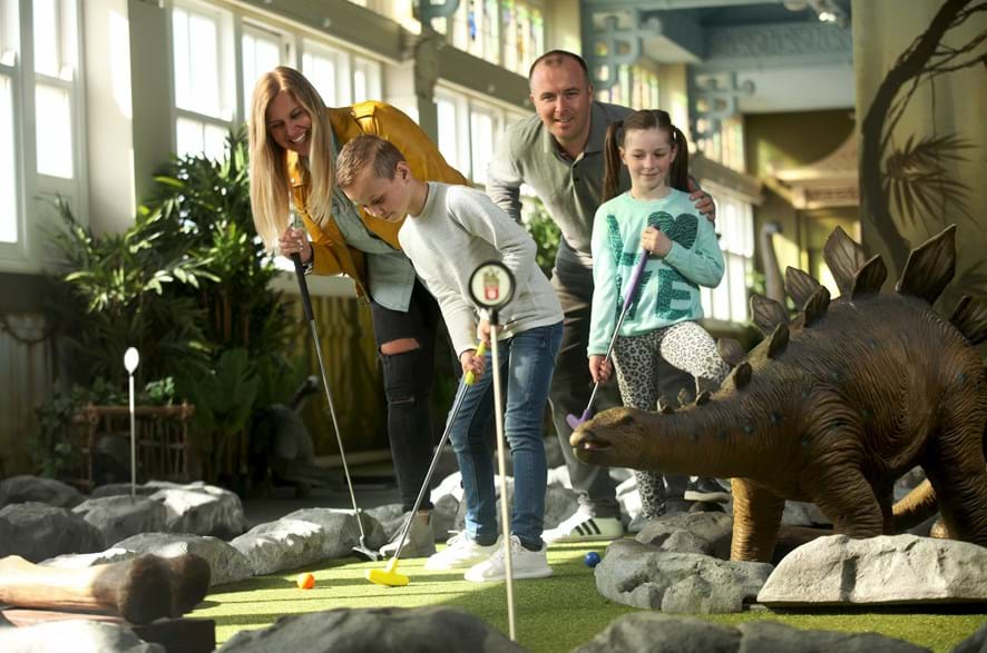 Family Playing Mini Golf at Dino Mini Golf at the Blackpool Tower