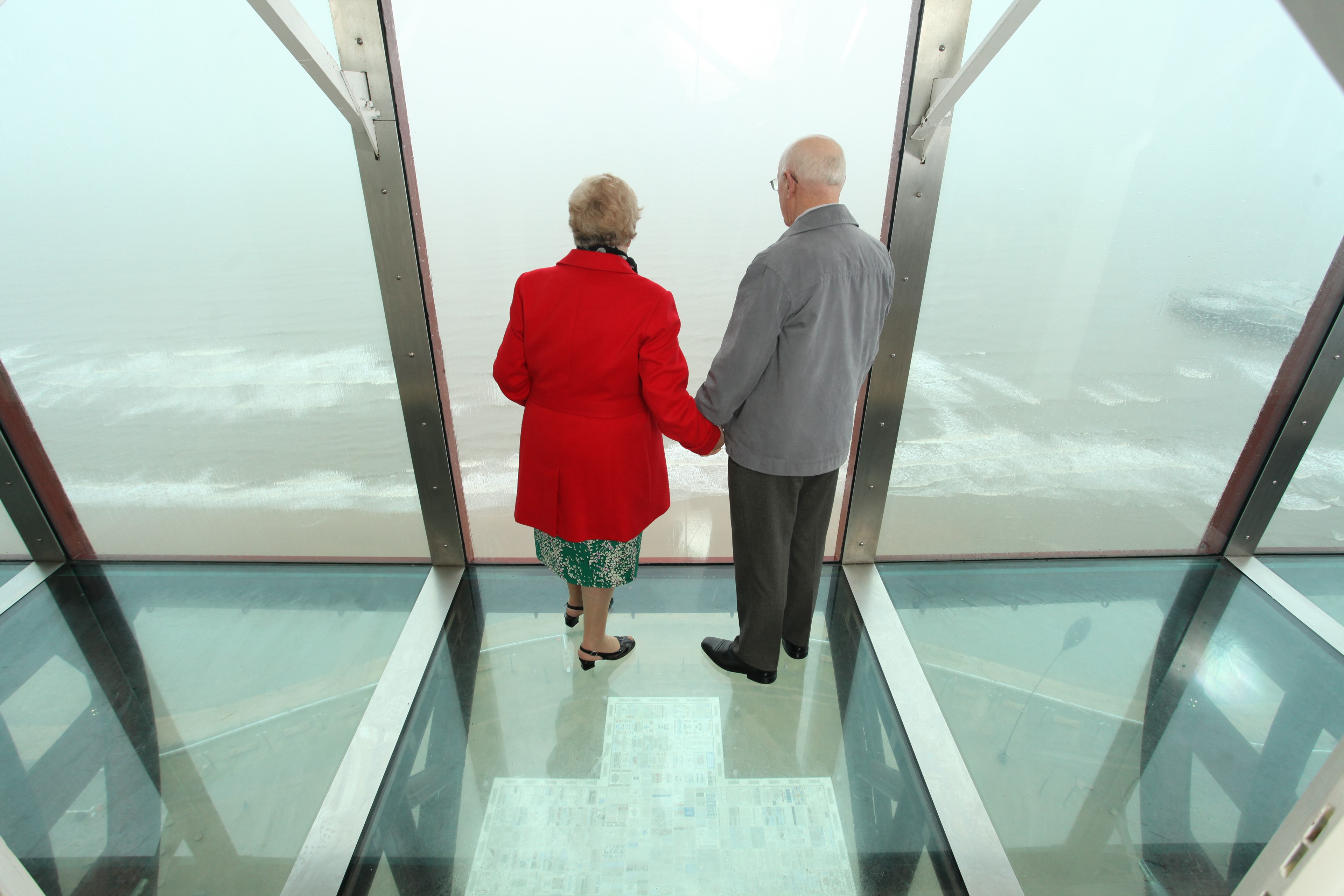 Couple looking at the view on top of the Blackpool Tower Eye
