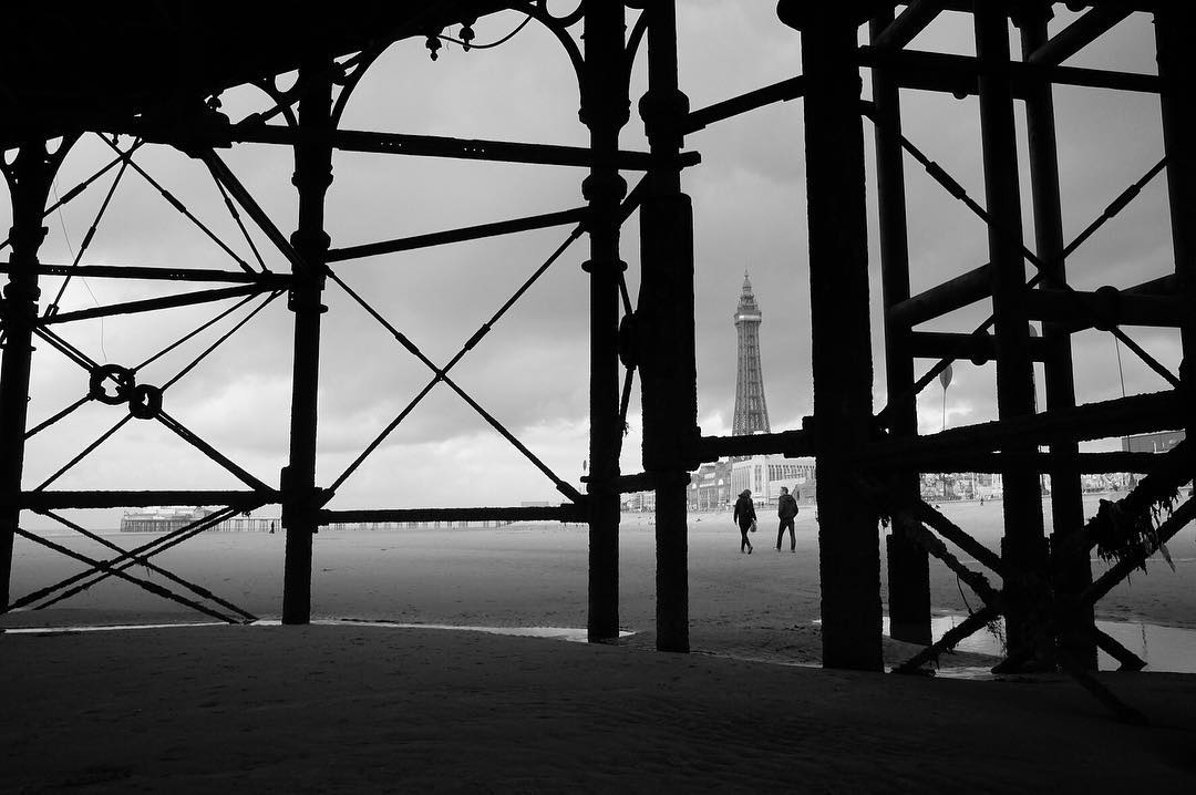 A view of the Blackpool Tower from the promenade in Black and White