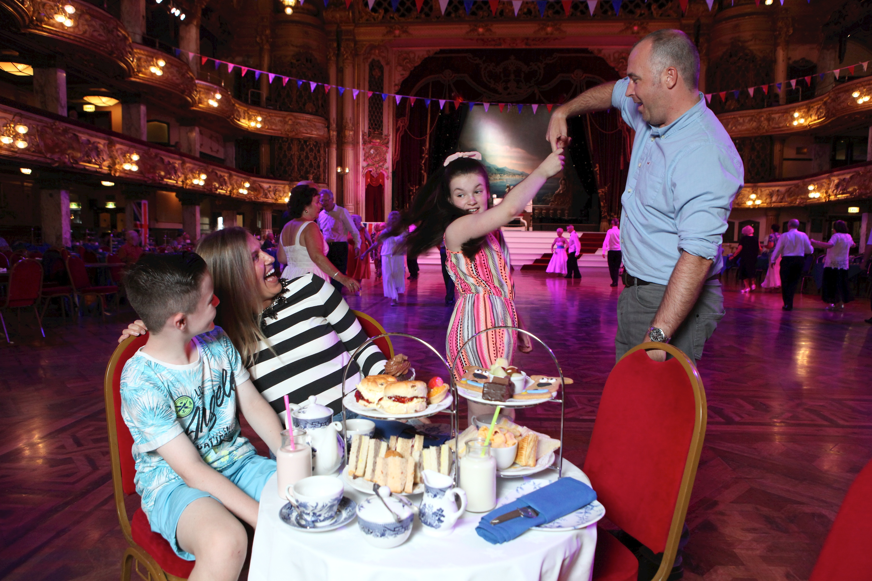 Family enjoying afternoon tea at the Blackpool Tower Ballroom